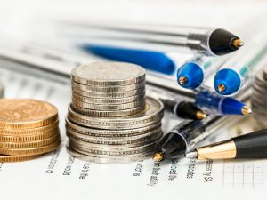 Coins and pens at tax time