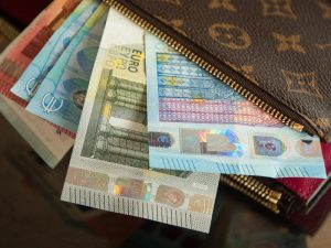 Wallet with Euro notes coming out